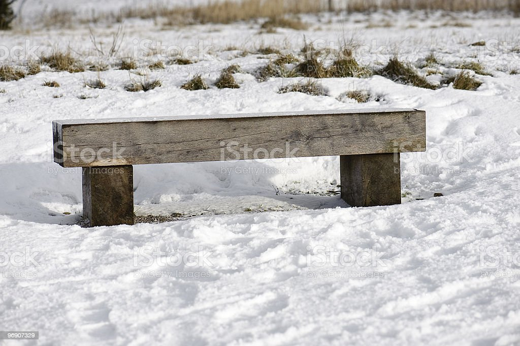 Plain bench in snowy setting. royalty-free stock photo