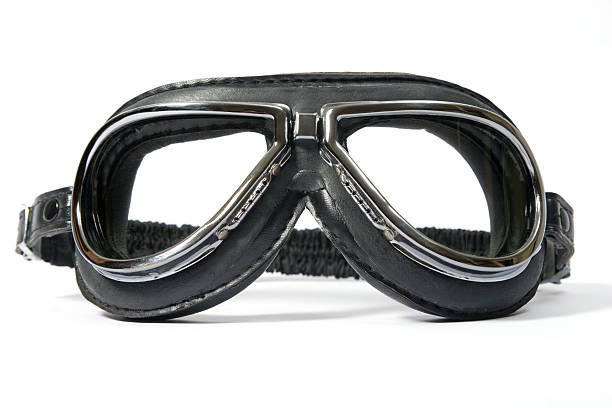 Plain black pilots goggles on white background stock photo