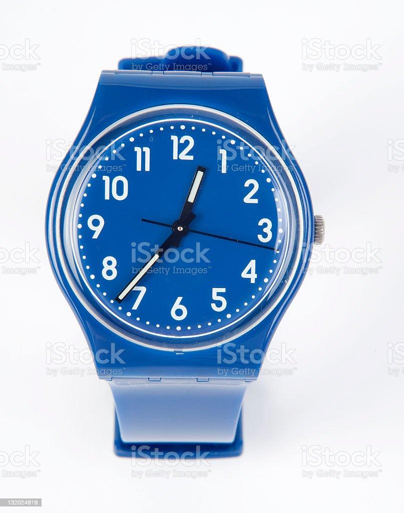 A plain blue and white wrist watch  stock photo