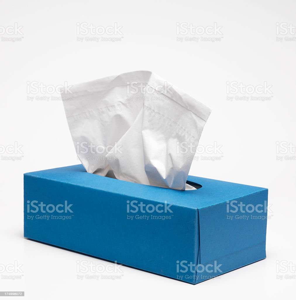 A plain blue tissue box on a white background stock photo