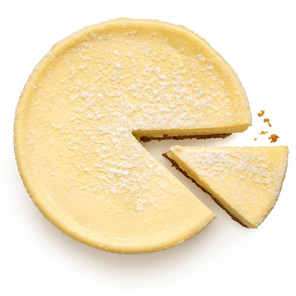 New York style cheesecake with a slice cut out isolated on white. Top view.