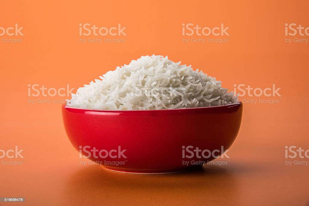 plain cooked white basmati or basamati rice in ceramic bowl stock photo