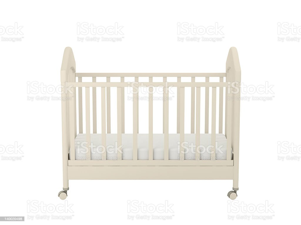 A plain cream colored crib with wheels stock photo