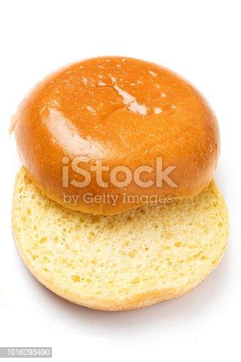 Plain hamburger bun on white background