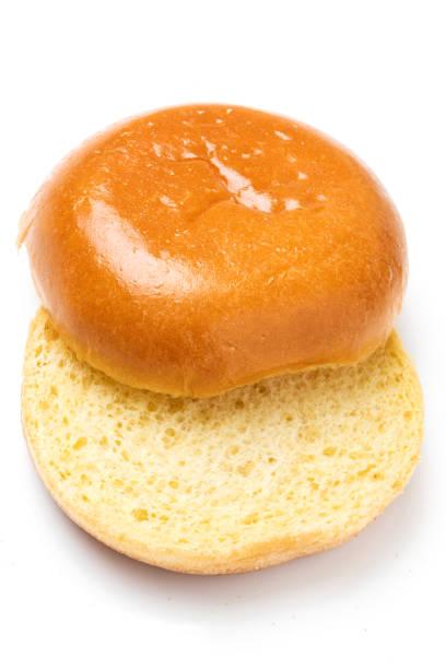 Plain hamburger bun Plain hamburger bun on white background sweet bun stock pictures, royalty-free photos & images