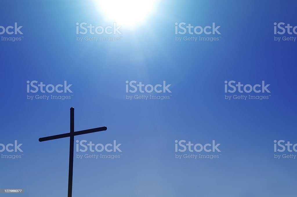 Plain Metal Cross and Sun royalty-free stock photo