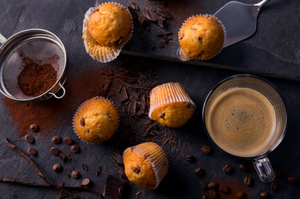 Plain mini muffins with chocolate chips on dark grey stone stock photo