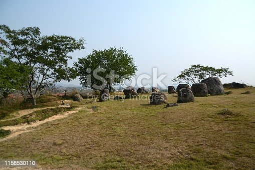 The Plain of Jars, a megalithic archaeological site in Laos., consisting of thousands of stone jars scattered around the upland valleys of the Xiangkhoang Plateau, located at the end of the Annamese Cordillera, the principal mountain range of Indochina. The Plain of Jars is dated to the Iron Age and is one of the most important prehistoric sites in Southeast Asia.