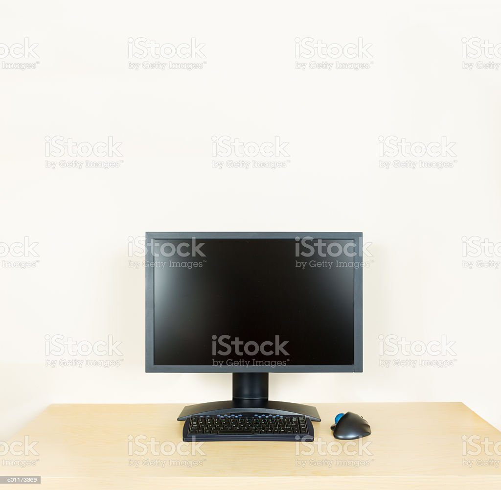 - Plain Office Desk With Monitor Stock Photo - Download Image Now