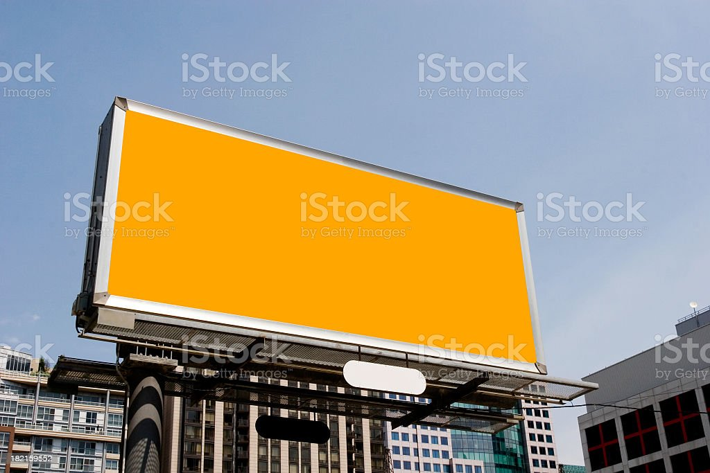 Plain orange billboard amongst office buildings stock photo