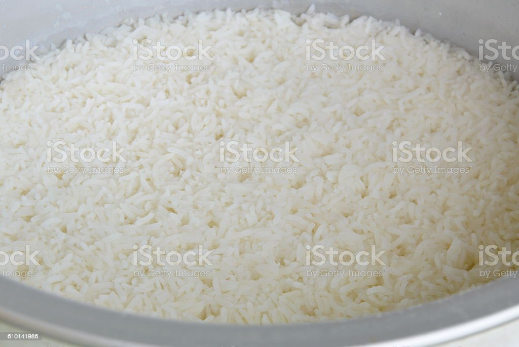 plain rice steamed in electric cooker stock photo