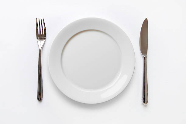 plain white plate with fork and knife on white background - table knife stock pictures, royalty-free photos & images