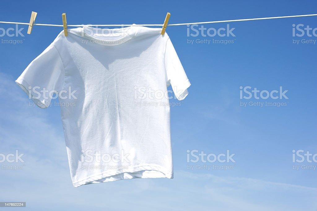 Plain White T-Shirt on a Clothesline stock photo