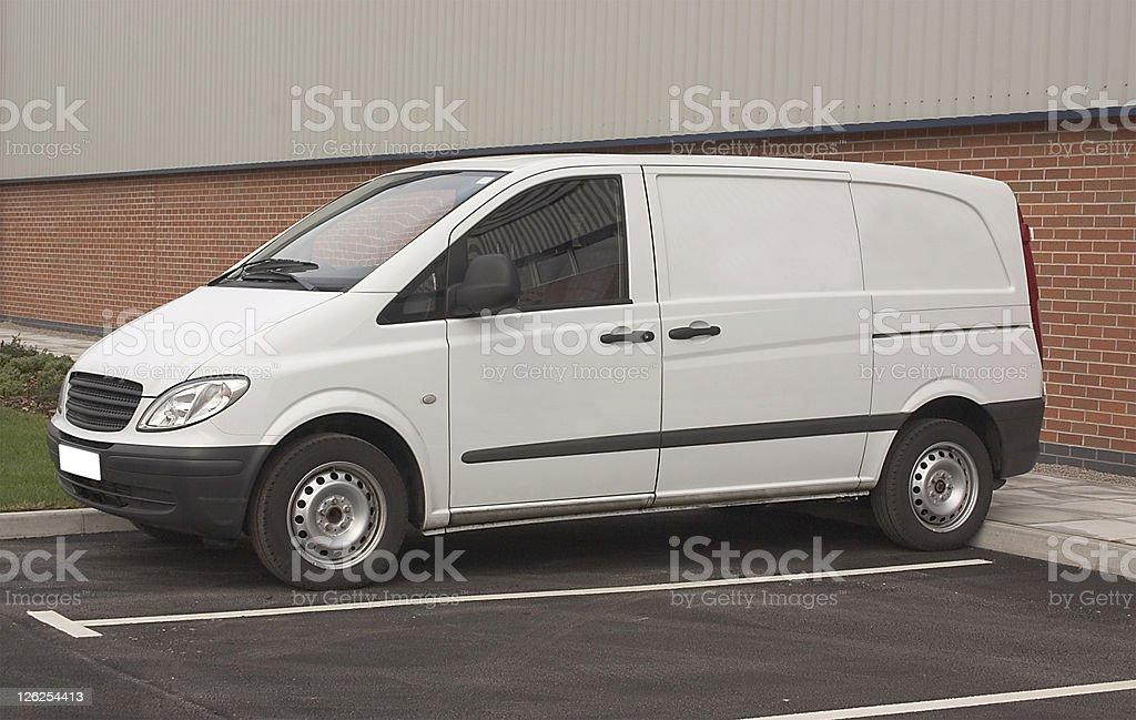 Plain white van in parking lot ready for branding royalty-free stock photo