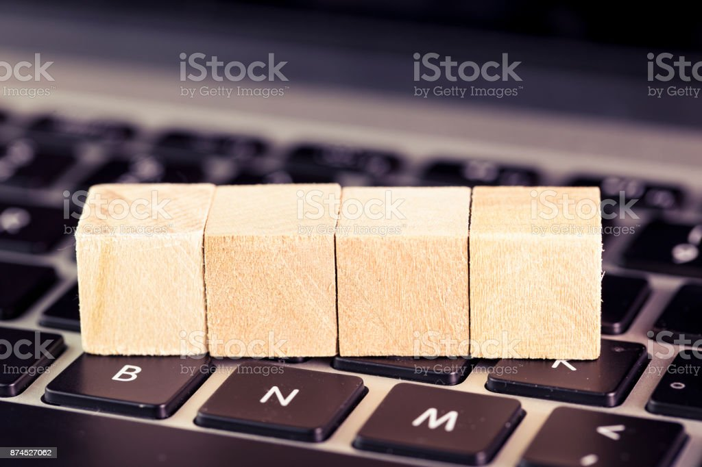 Plain Wooden Cube On Laptop Keyboard Selective Focus On Wooden Cube