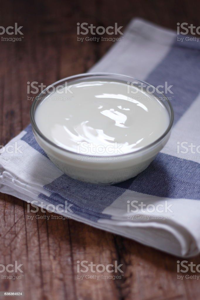 plain yogurt in small glass bowl stock photo