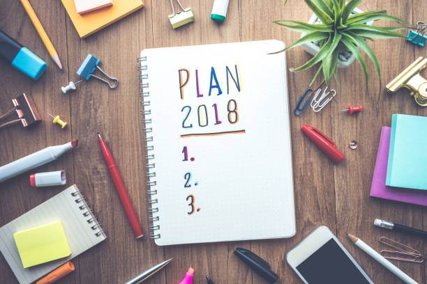 Plan 2018 message with notepad paper on wooden table stock photo