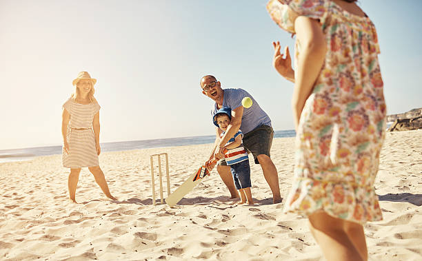 plan a fun day at the beach - cricket stock photos and pictures