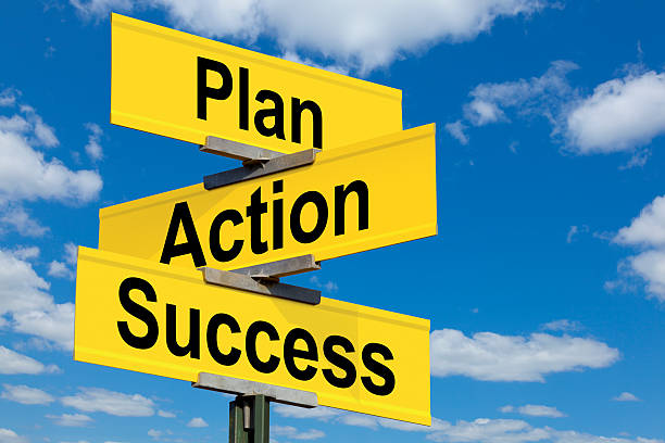 Plan, Action, Success, Intersection Road Sign stock photo