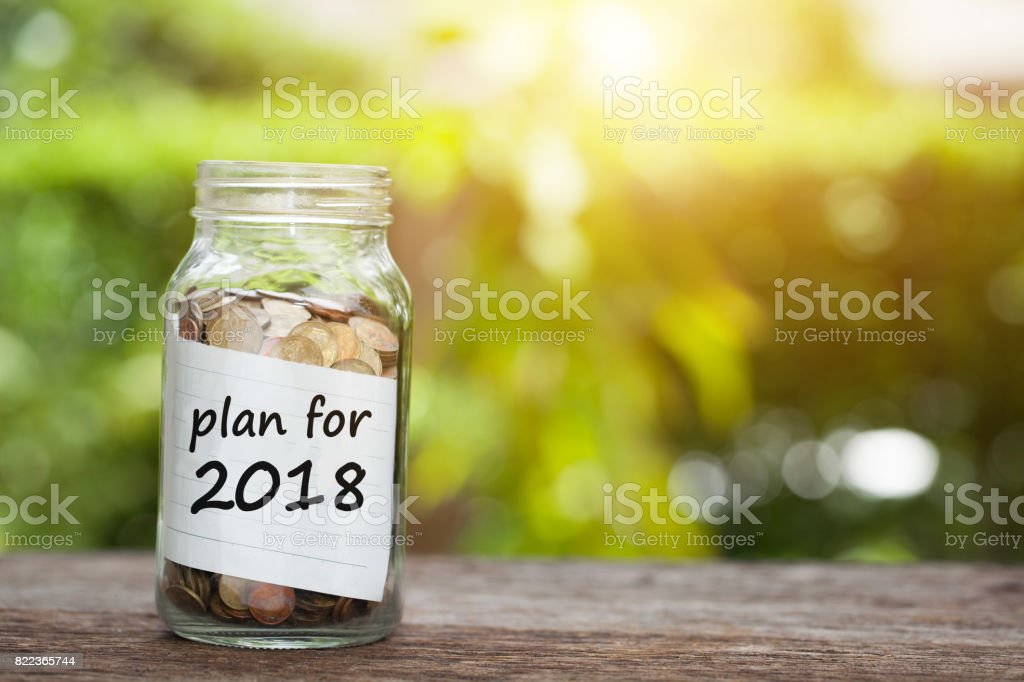 Plan For 2018 Word With Coin In Glass Jar. stock photo