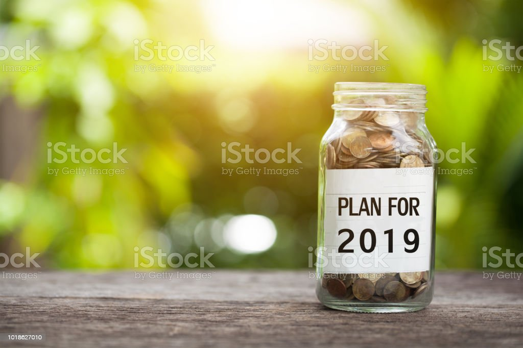 Plan For 2019 Word With Coin In Glass Jar. stock photo