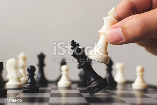 Plan leading strategy of successful business competition leader concept, Hand of player chess board game putting white pawn, Copy space for your text