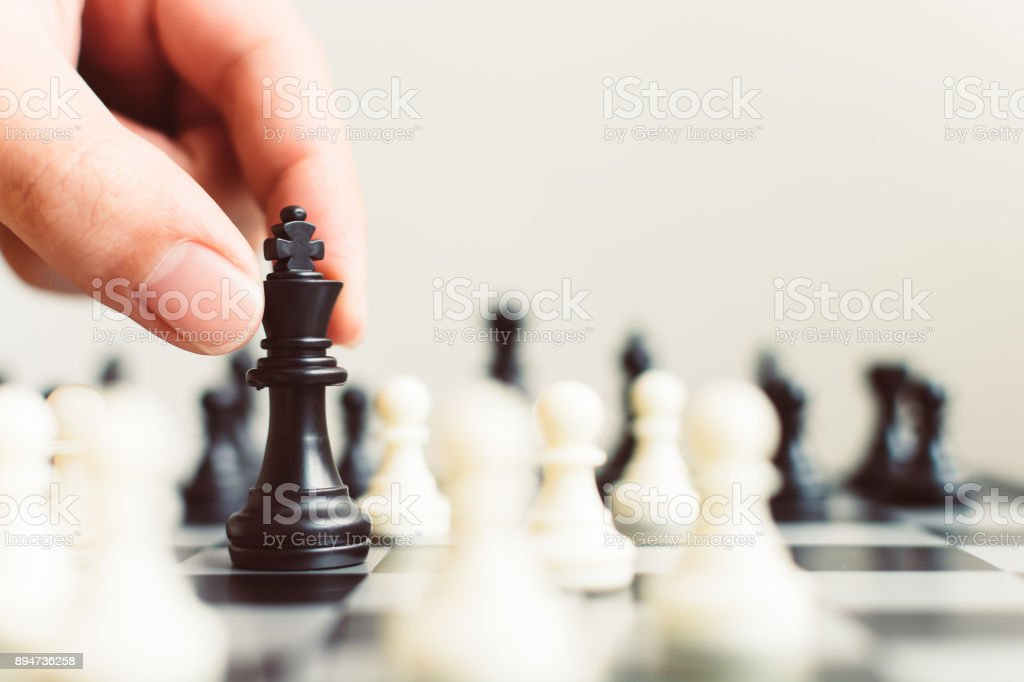 Plan leading strategy of successful business competition leader concept, Hand of player chess board game putting black pawn, Copy space for your text stock photo