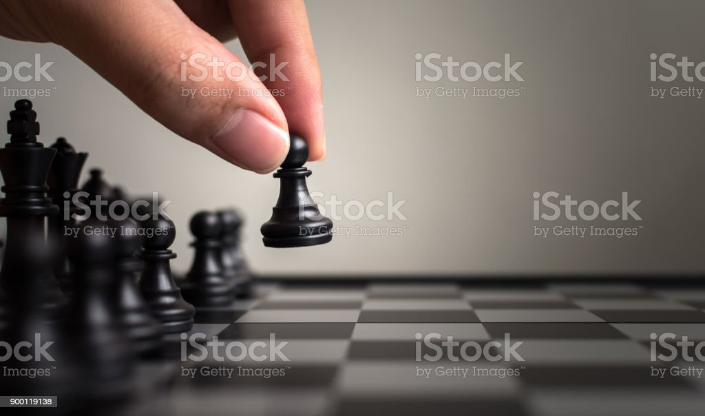 Plan leading strategy of successful business leader concept, Hand of player chess board game putting black pawn, Copy space for your text stock photo