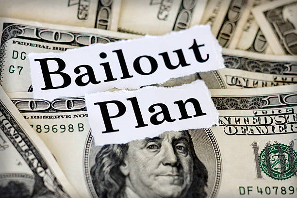 "plan Hundred dollar bills with the words ""bailout plan."" bailout stock pictures, royalty-free photos & images"