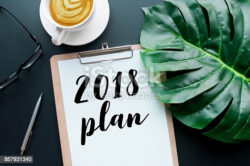 istock 2018 plan text on notepad with office accessories. 857931340