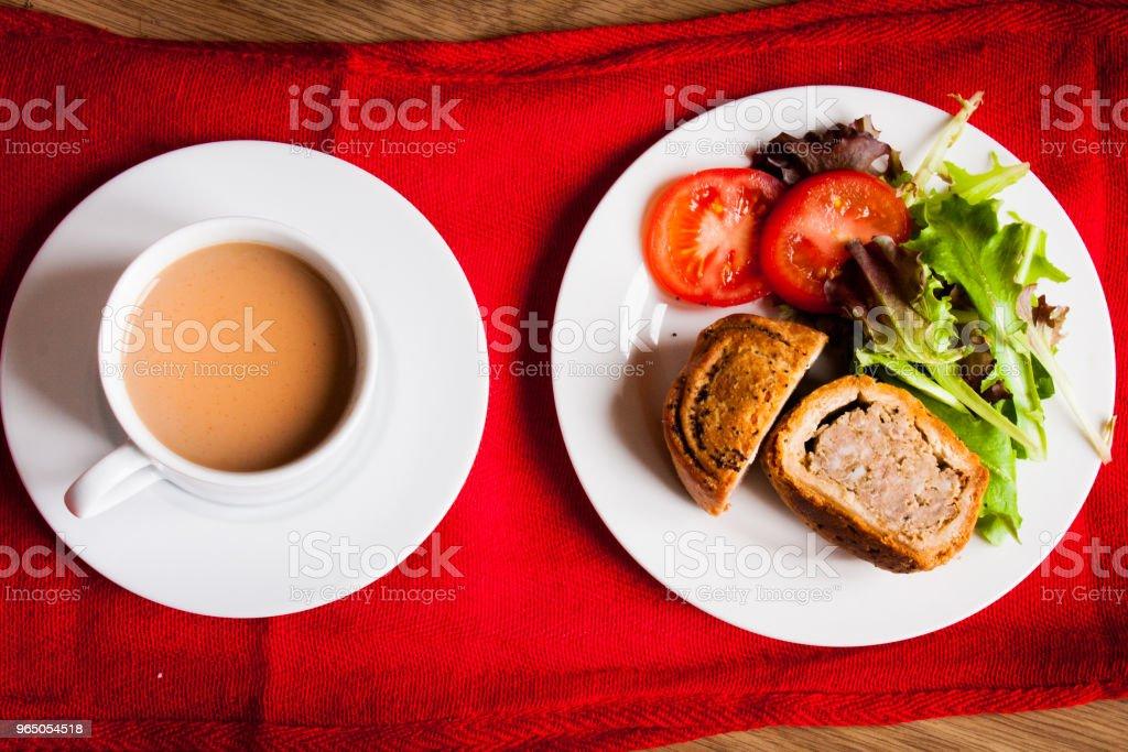 Plan view of pork and bramley apple pie with salad and hot drink zbiór zdjęć royalty-free