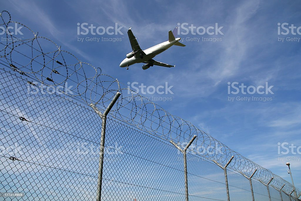 A plane about to land at an airport royalty-free stock photo