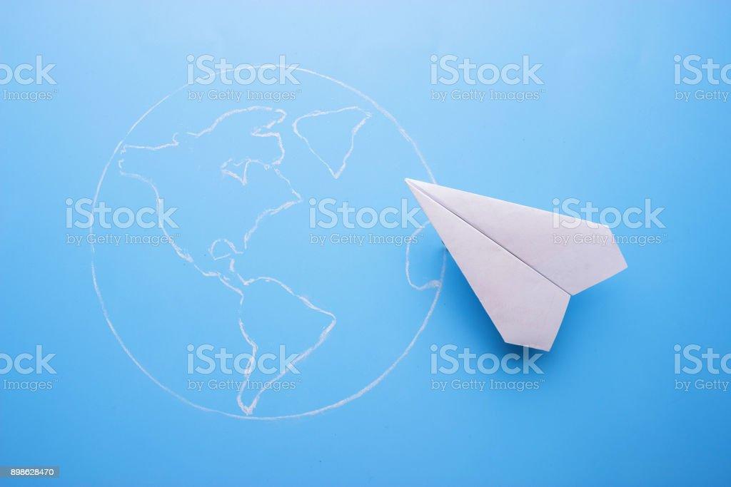 plane above world map stock photo