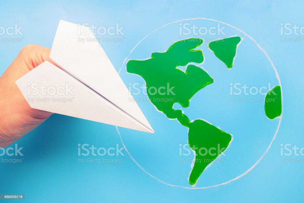 plane above world map stock photo
