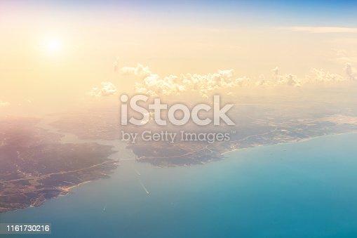 istock Plane aerial view of Bosphorus strait and  Yavuz Sultan Selim Bridge in Istanbut Turkey. Scenic  dramatic sunset cloudy sky over Bosporus strait  turkish landmark 1161730216