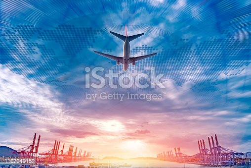 a plane flying over a trading port