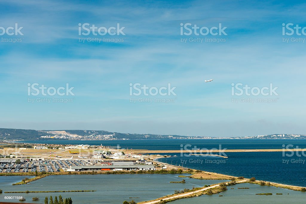 plane at airport in Marseilles taking off stock photo