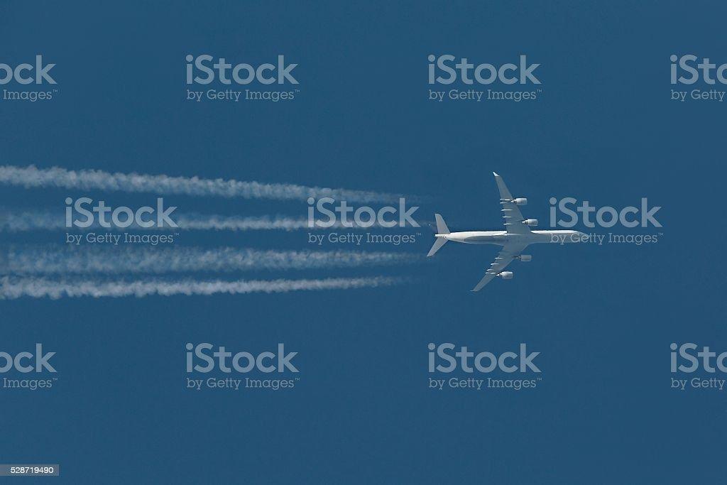 Plane at cruising altitude stock photo