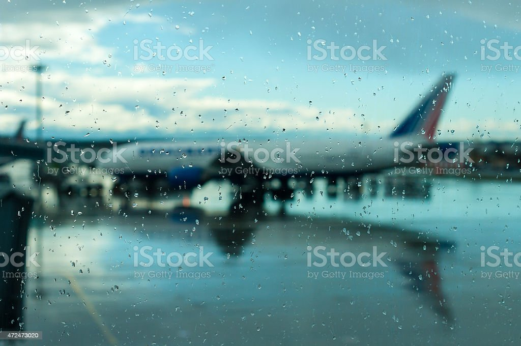Plane at the airport. Bad weather, hurricane. Flight delays, transport stock photo