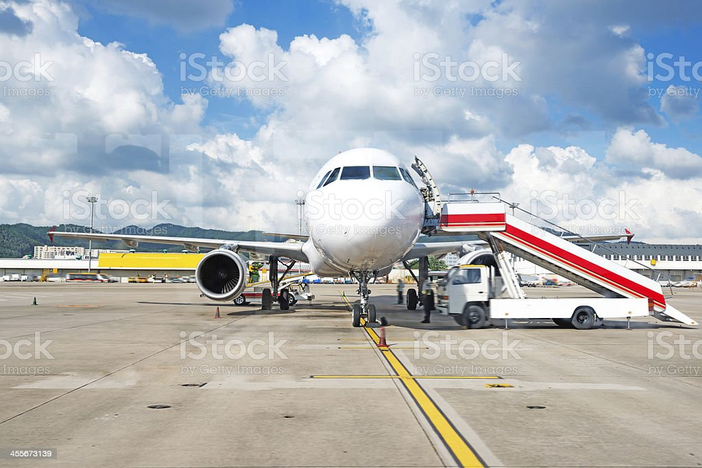 plane at the airport on loading stock photo