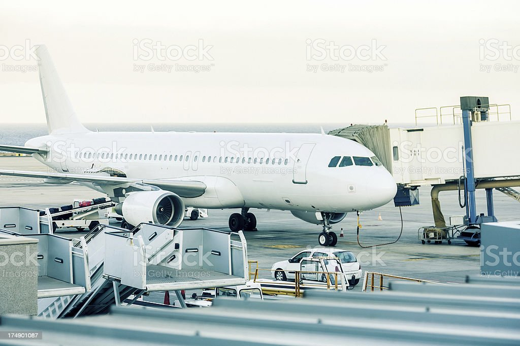 Plane at the airport royalty-free stock photo