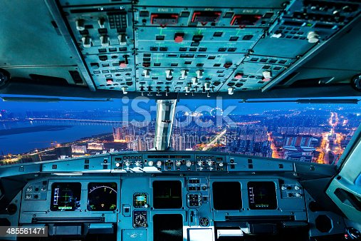 istock plane cockpit and city of night 485561471