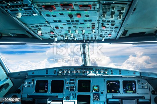 istock plane cockpit and cloudy sky 490690457