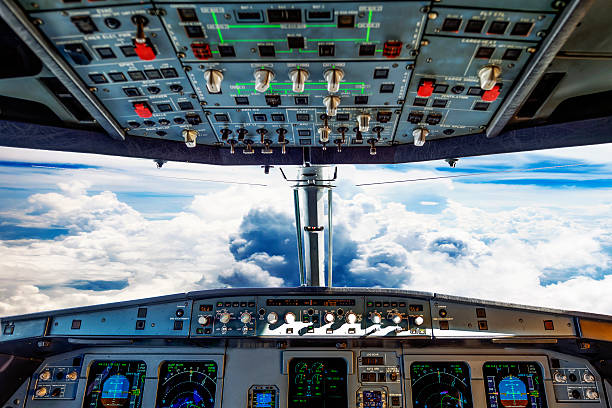 plane cockpit and cloudy sky - cockpit stock photos and pictures