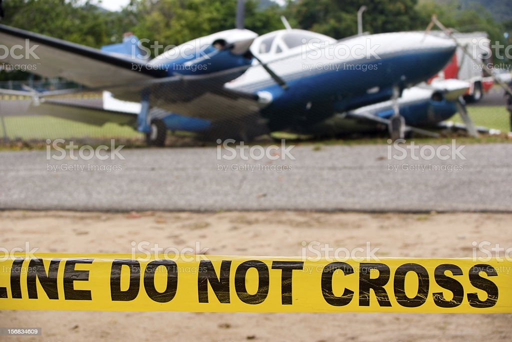 plane crash scene; police line do not cross royalty-free stock photo