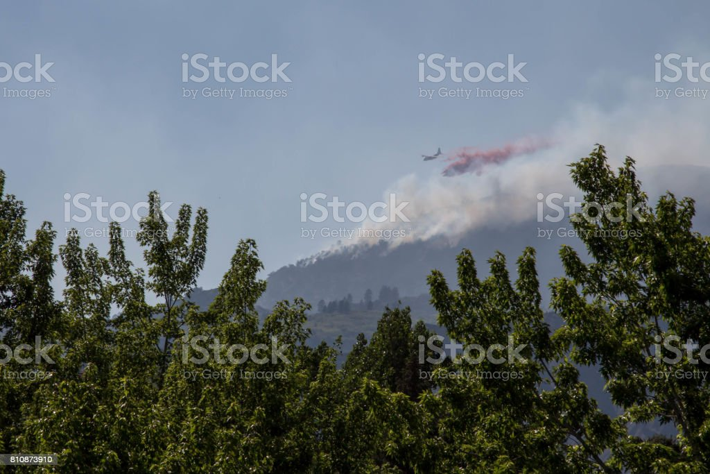 Plane dropping fire retardant on Lightner Creek Fire in Durango, Colorado stock photo