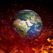 Plane Earth in fire isolated on black background. Global warming, crisis concept.