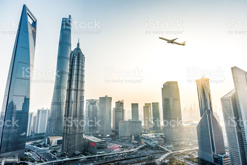 Plane fly over City stock photo