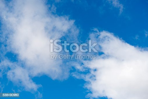 istock Plane flying above the clouds 538490980