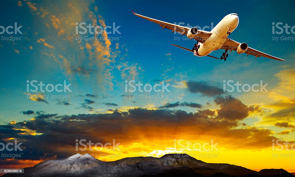 plane flying against beautiful sun rising sky for traveling them stock photo